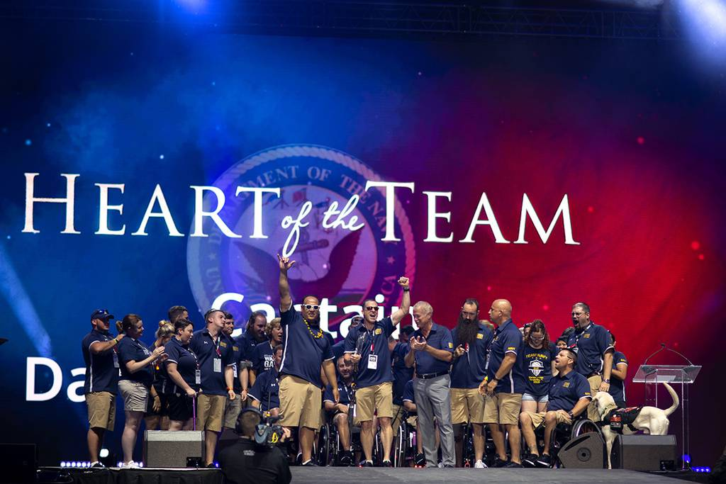 Coast Guard Capt. Daryl Schaffer, center, celebrates with Team Navy after being awarded the Heart of the Team award on June 30 during the closing ceremony of the 2019 DoD Warrior Games in Tampa, Fla.