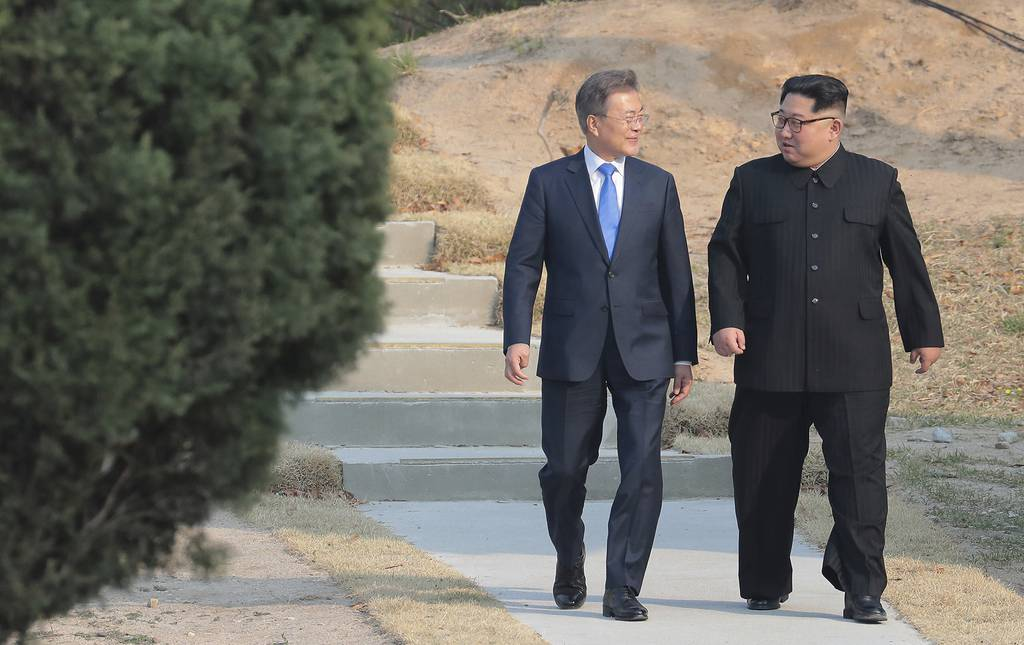 In this April 27, 2018, file photo, North Korean leader Kim Jong Un, right, and South Korean President Moon Jae-in stroll together at the border village of Panmunjom in the Demilitarized Zone, South Korea.