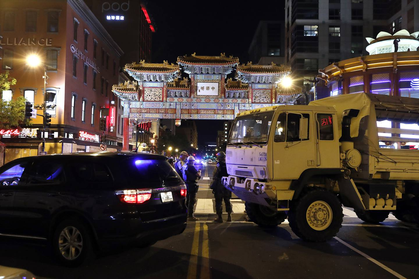 A military Humvee blocks an intersection in the Chinatown section of downtown Washington as demonstrators protest the death of George Floyd, Monday, June 1, 2020, in Washington.