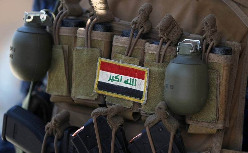 An Iraqi flag patched on the ammunition belt of a member of the Iraqi forces is seen June 19, 2017, during an offensive to retake the last district still held by the Islamic State group fighters in Mosul.