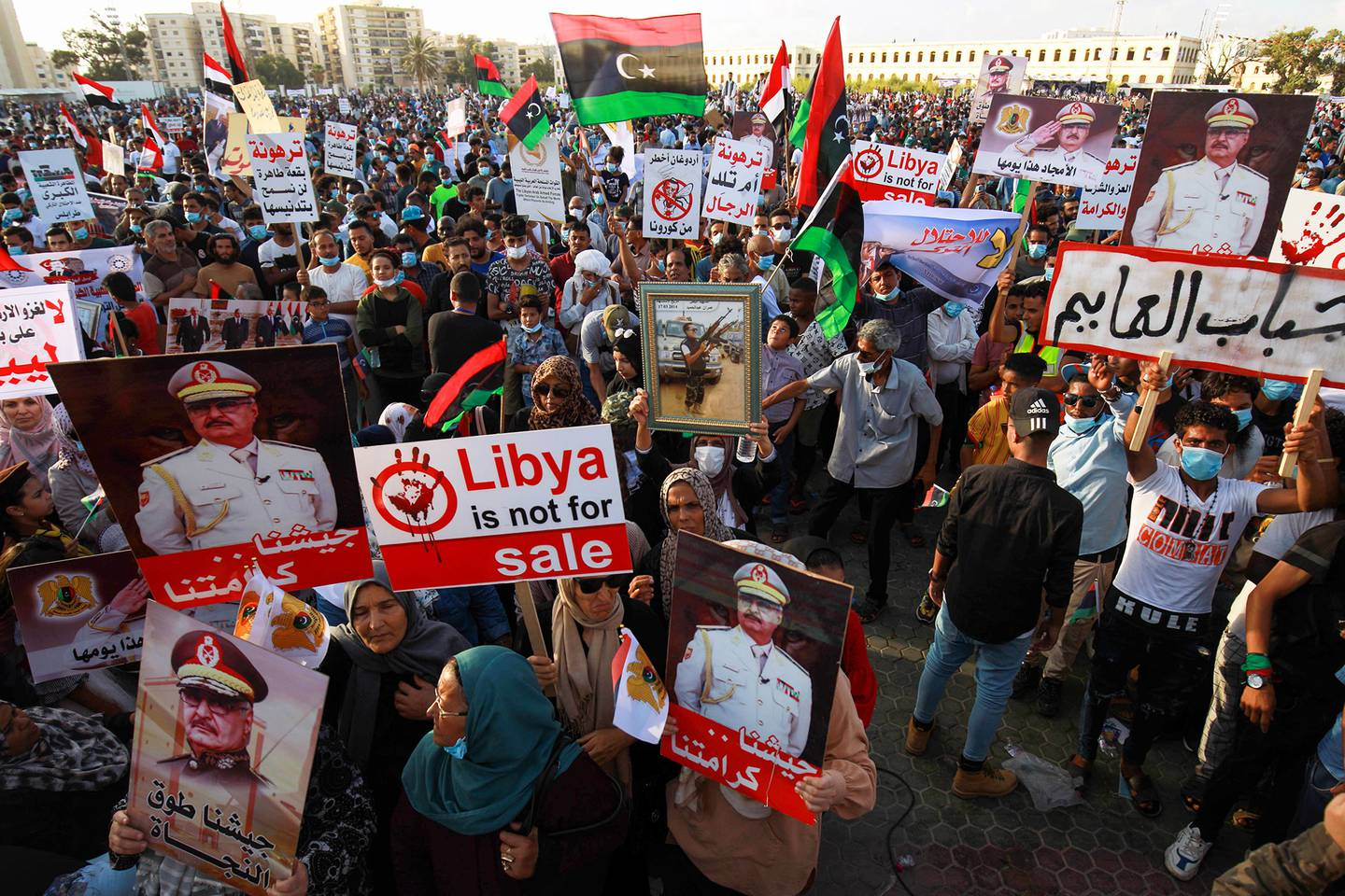 Supporters of Libyan military strongman Khalifa Haftar take part in a gathering in the eastern Libyan port city of Benghazi on July 5, 2020, to protest against Turkish intervention in the country's affairs.