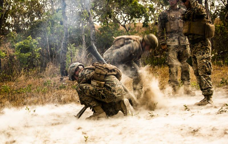 Marines with 3rd Battalion, 3rd Marine Regiment,  a part of Marine Rotational Force - Darwin, fire an M252 81mm extended range mortar system during a fire support coordination exercise at Mount Bundey Training Area, Australia, Aug. 9, 2019.
