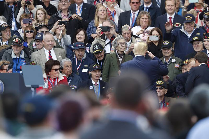 U.S. President Donald Trump salutes to veterans prior to a ceremony to mark the 75th anniversary of D-Day at the Normandy American Cemetery