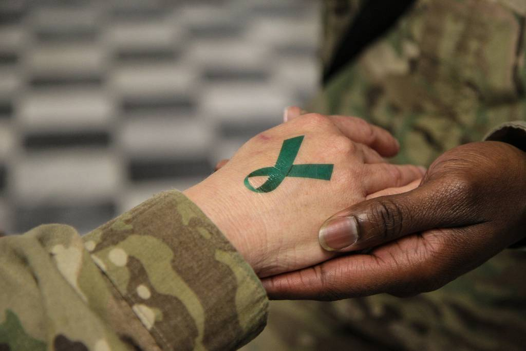 A temporary teal ribbon tattoo is seen on a soldier's hand at Bagram Airfield in Afghanistan on April 2, 2014.