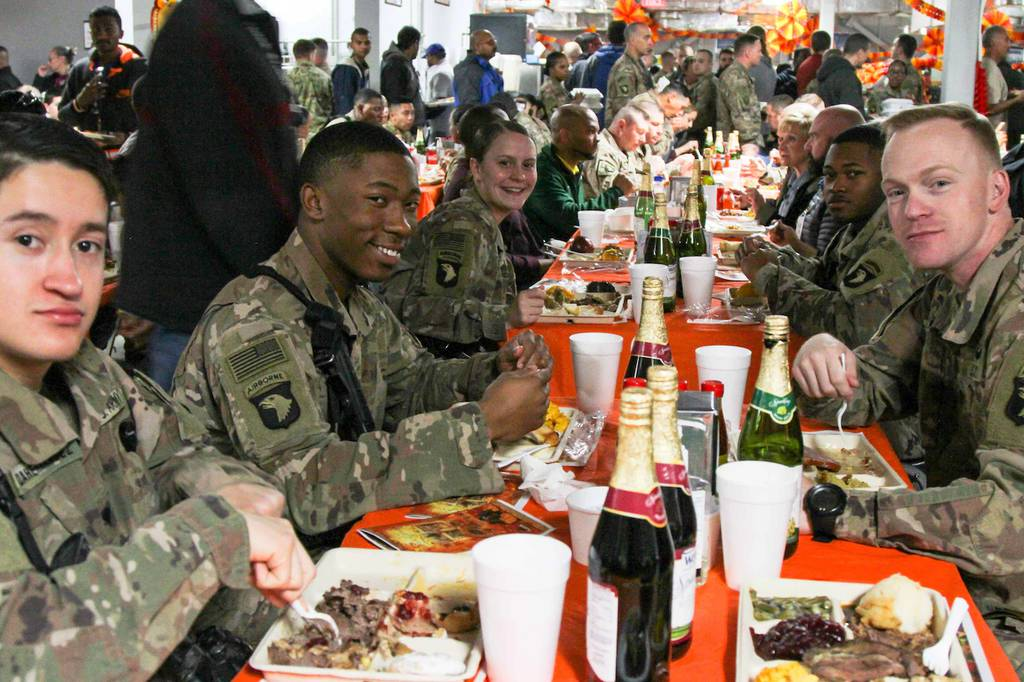 Soldiers at Bagram Airfield in Afghanistan enjoy Thanksgiving dinner in 2018. While this year's Thanksgiving meal may look different, the Defense Logistics Agency Troop Support has been providing traditional Thanksgiving food to field kitchens, dining facilities and galleys to locations in the United States and around the world. (Photo: Army Staff Sgt. Caitlyn Byrne)