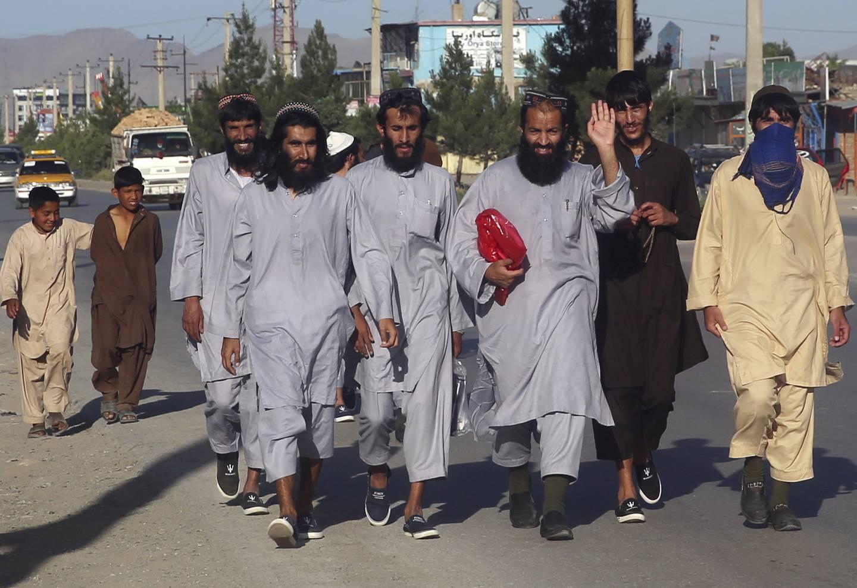 Afghan Taliban prisoners freed from Bagram Prison walk in Kabul, Afghanistan, Tuesday, May 26, 2020.