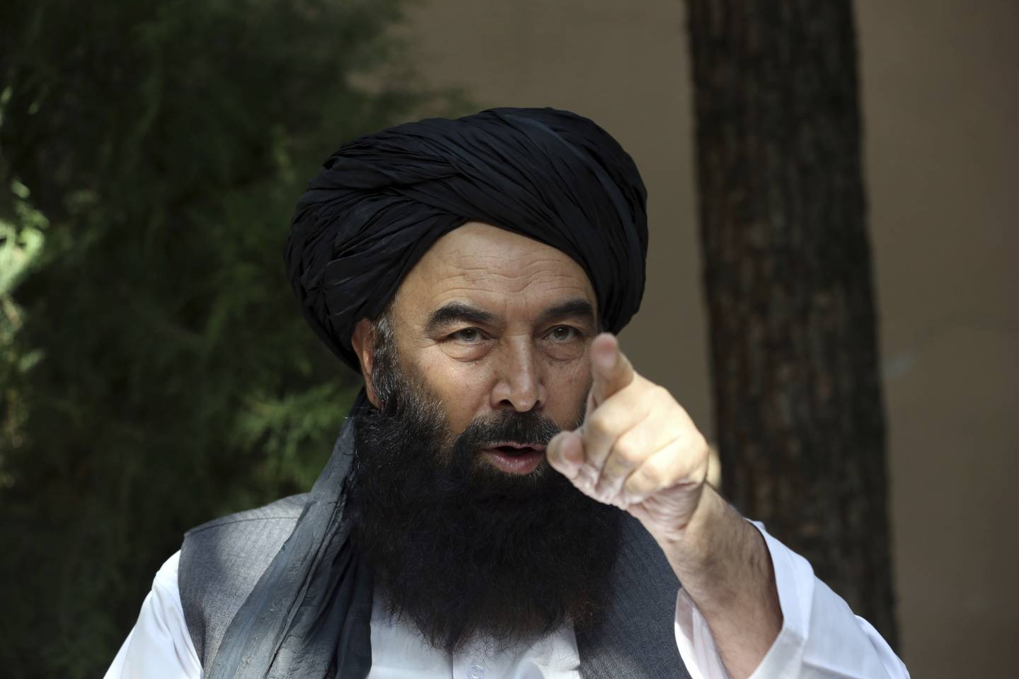 In this Thursday, Aug. 29, 2019, photo, A former Taliban military leader Syed Akbar Agha speaks during an interview with the Associated Press in Kabul, Afghanistan.