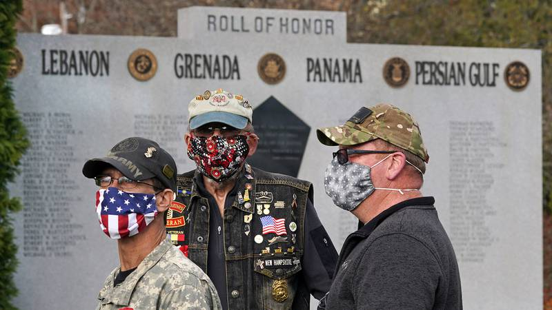 Veterans, wearing protective masks due to the COVID-19 virus outbreak, gather during a Veterans Day ceremony, Wednesday, Nov. 11, 2020, in Derry, N.H.
