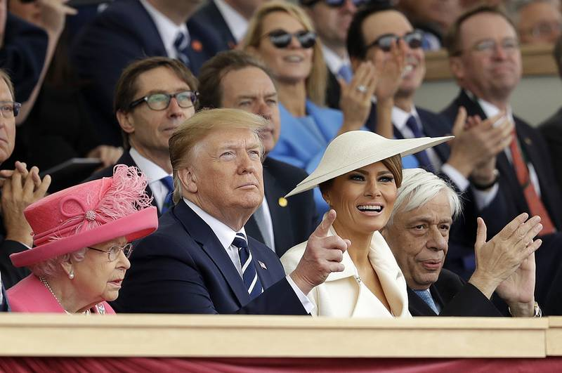 Queen Elizabeth II, President Donald Trump, first lady Melania Trump and Greek President Prokopis Pavlopoulos, from left, applaud as they watch a fly past at the end of an event to mark the 75th anniversary of D-Day in Portsmouth, England