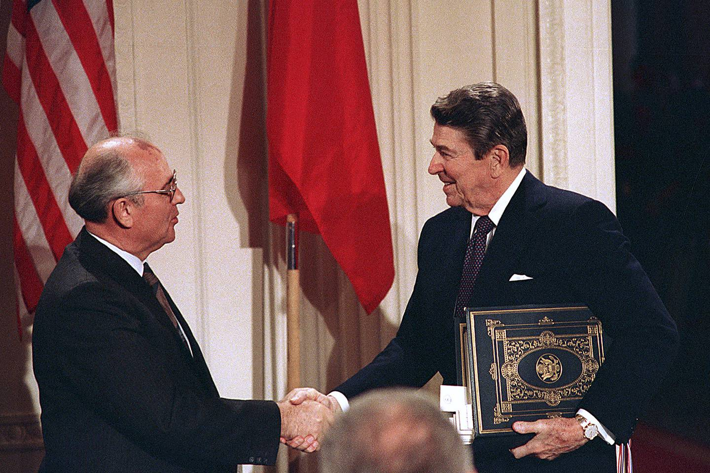 In this Dec. 8, 1987, file photo, President Ronald Reagan, right, shakes hands with Soviet leader Mikhail Gorbachev after the two leaders signed the Intermediate Range Nuclear Forces Treaty to eliminate intermediate-range missiles during a ceremony in the White House East Room in Washington.