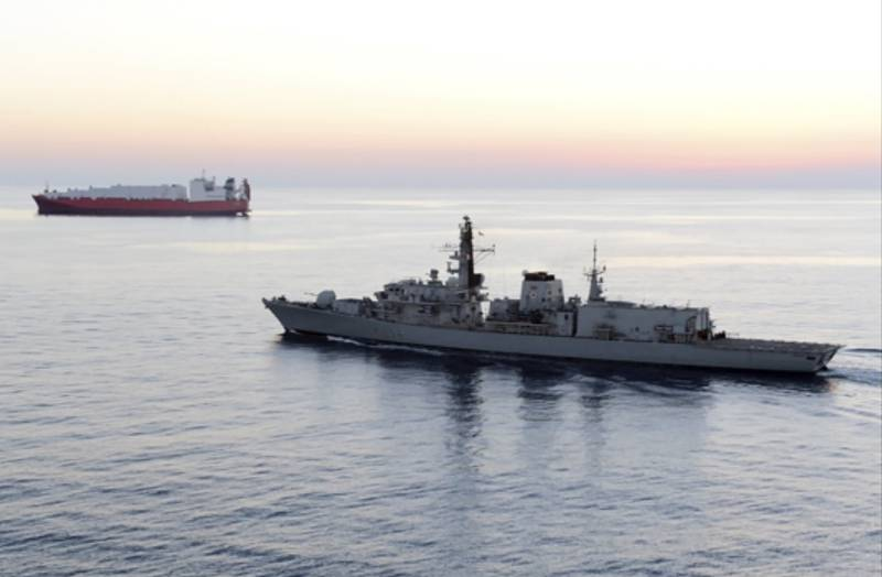 British navy vessel HMS Montrose escorts another ship during a mission to remove chemical weapons from Syria at sea off coast of Cyprus in February 2014.