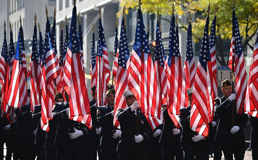 People attend the Veterans Day parade at 5th Avenue on Nov. 11, 2019, in New York City.