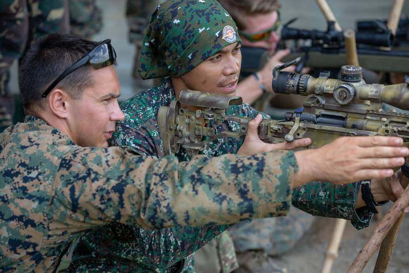 A U.S. Marine shares his knowledge of the M40A6 sniper rifle with a Philippine Marine during KAMANDAG 3 at Fort Magsaysay, Philippines, Oct. 14, 2019.