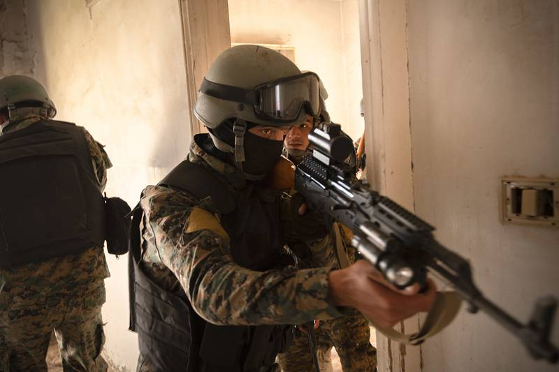 Syrian Democratic Force commando cadets clear a room during military operations in urban terrain training in Syria, Aug. 3, 2019.