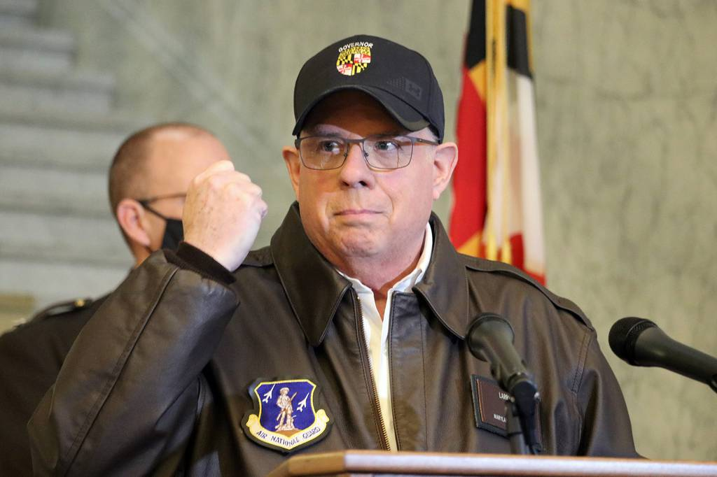Maryland Gov. Larry Hogan holds his hand up during a news conference in Annapolis, Md., on Thursday, Jan. 7, 2021, as he describes phone conversations he had with Maryland Rep. Steny Hoyer and Secretary of the Army Ryan McCarthy on sending Maryland National Guard members to help protect the U.S. Capitol after rioters stormed the building a day earlier.