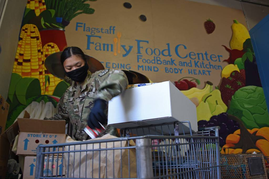 Arizona National Guard personnel deliver boxes of fresh produce and groceries to residents of Coconino County, Ariz., April 7, 2020, at Flagstaff Family Food Center.