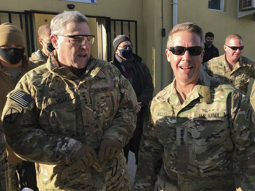 Chairman of the U.S. Joint Chiefs of Staff Gen. Mark Milley, left, talks with Gen. Scott Miller, the commander of U.S. and coalition forces in Afghanistan, Wednesday, Dec. 16, 2020 at Miller's military headquarters in Kabul, Afghanistan.