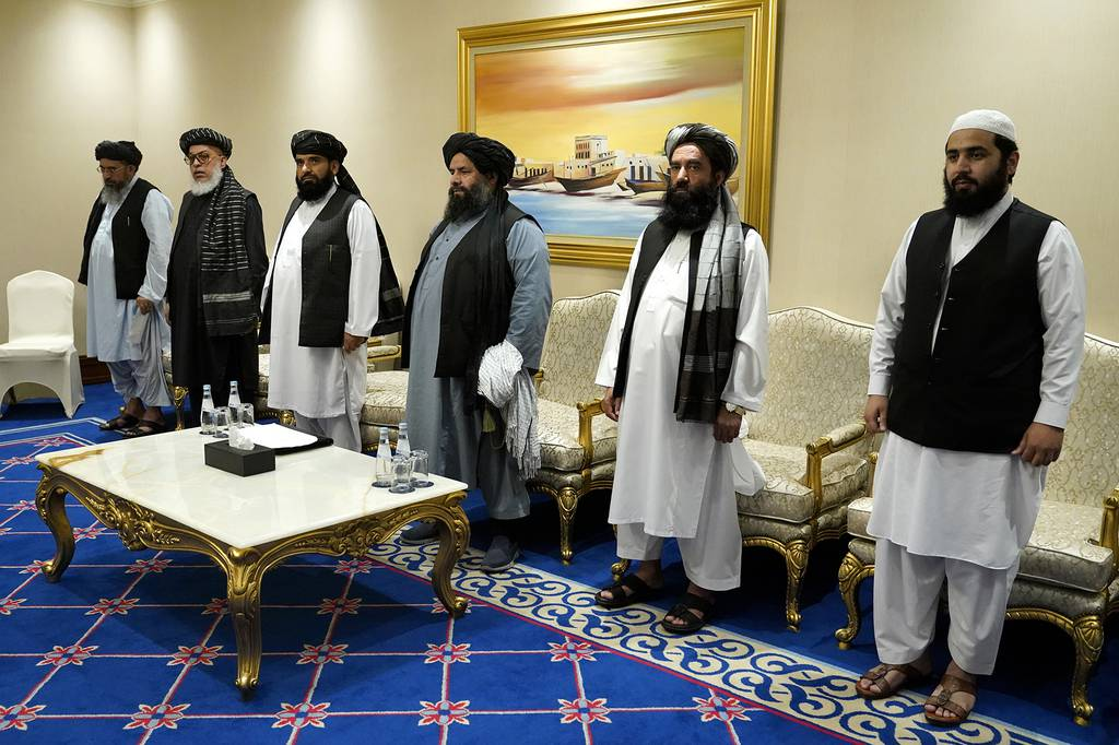 Members of the Taliban's peace negotiation team meet with Secretary of State Mike Pompeo amid talks between the Taliban and the Afghan government, Saturday, Nov. 21, 2020, in Doha, Qatar.