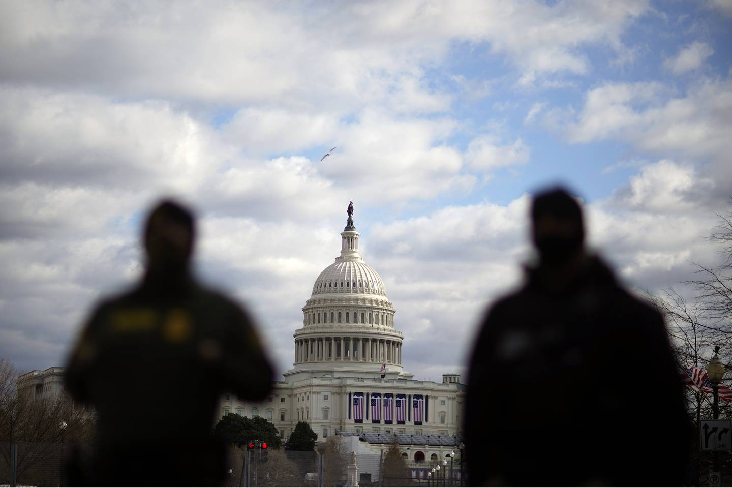 Law enforcement stand near the Capitol ahead of the inauguration of President-elect Joe Biden and Vice President-elect Kamala Harris, Sunday, Jan. 17, 2021, in Washington.
