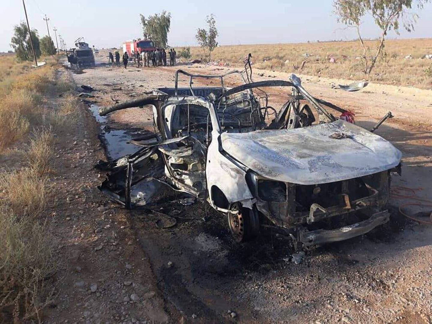 This photo released by Popular Mobilization Forces shows shows the aftermath of a drone attack near Qaim border crossing with Syria, in Anbar province