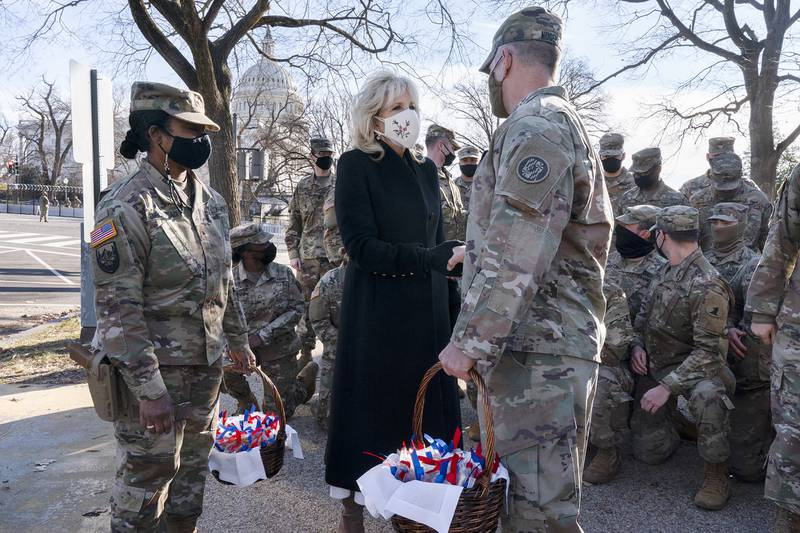 """Saying, """"The Biden's are a National Guard family,"""" first lady Jill Biden greets members of the National Guard with chocolate chip cookies Jan. 22, 2021, at the U.S. Capitol in Washington."""