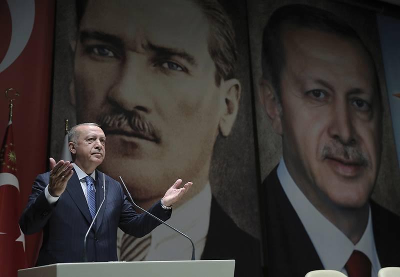 Turkey's President Recep Tayyip Erdogan addresses his ruling party members in Ankara on July 26, 2019.