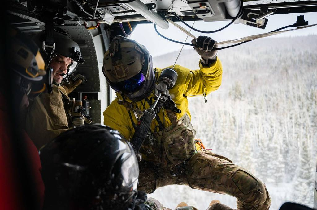 Airmen assigned to the 210th and 212th Rescue Squadrons participate in a rescue exercise near Eielson Air Force Base, Alaska, March 26, 2021. The 212th RQS provides elite pararescuemen, combat rescue officers and Survival, Evasion, Resistance, and Escape specialists to carry out the 176th Wing's wartime and peacetime rescue missions. (Airman 1st Class Jose Miguel T. Tamondong/Air Force)