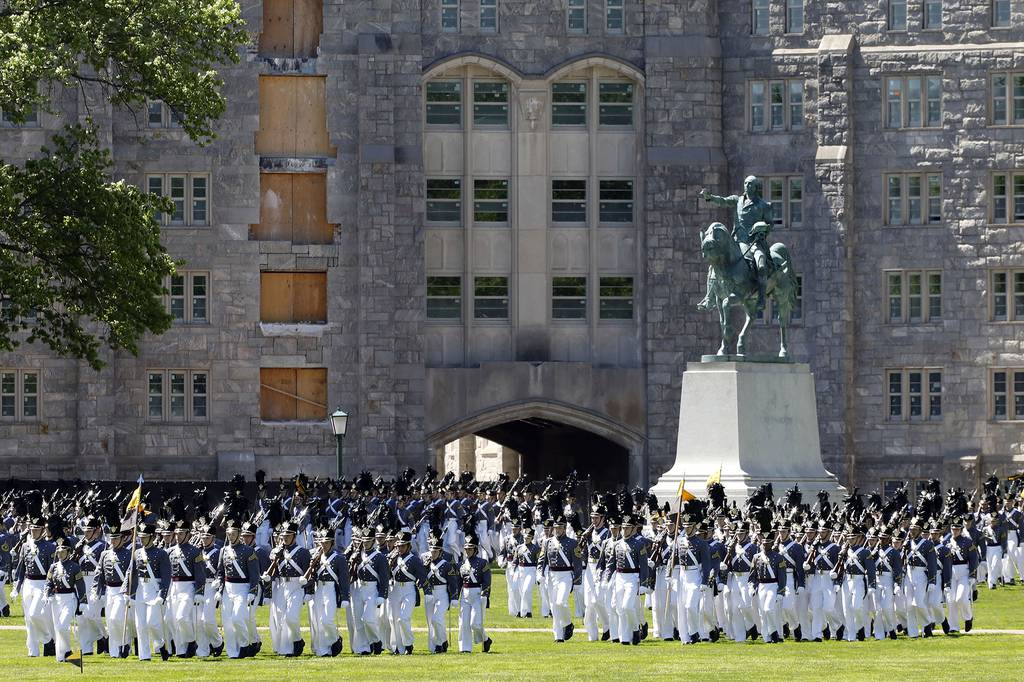 In this May 22, 2019, file photo, members of the senior class march past a statue of George Washington during Parade Day at the U.S. Military Academy in West Point, N.Y.