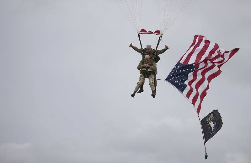 World War II D-Day veteran Tom Rice parachutes in a tandem jump into a field in Carentan, Normandy, France.