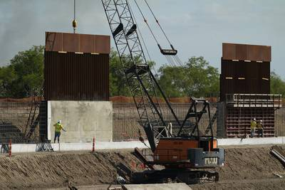 Construction workers build a border wall in Mission, Texas, Monday, Nov. 16, 2020.