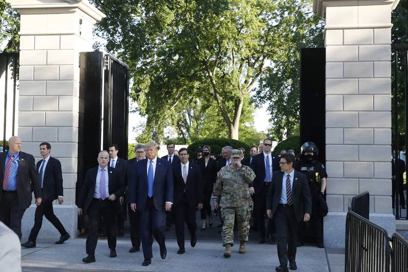 President Donald Trump walks from the gates of the White House to visit St. John's Church across Lafayette Park Monday, June 1, 2020, in Washington.