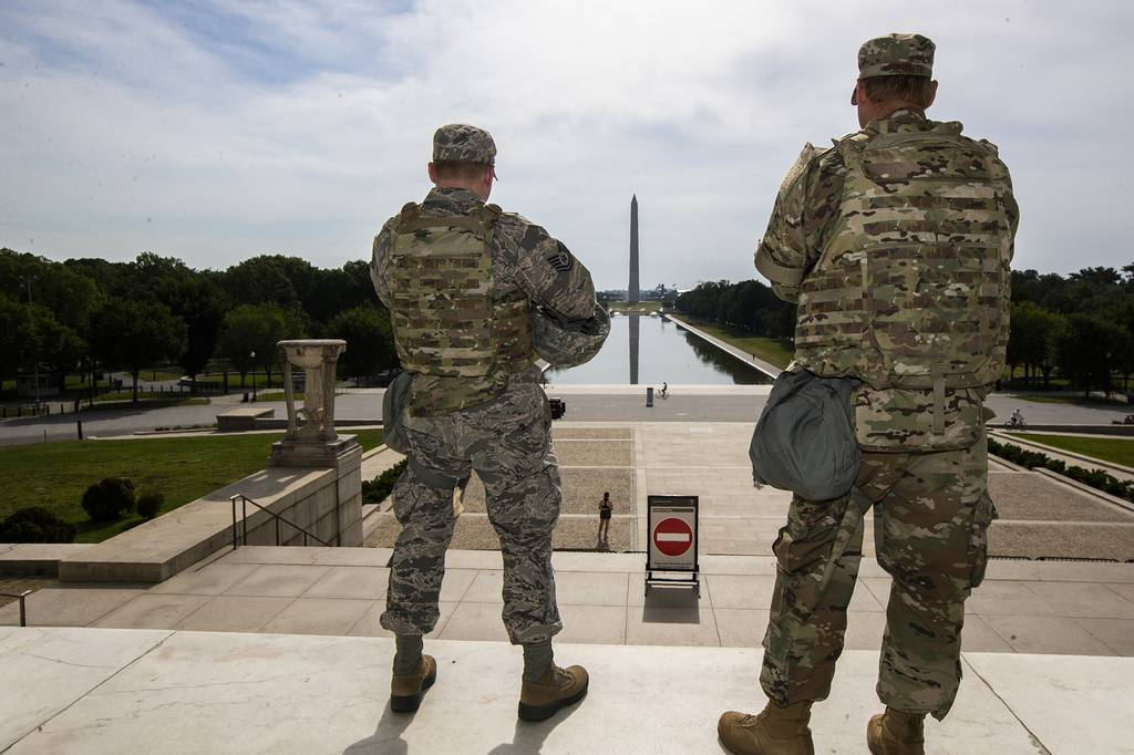 Members of the District of Columbia Army National Guard stand guard at the Lincoln Memorial in Washington, Wednesday, June 3, 2020, securing the area as protests continue following the death of George Floyd, a who died after being restrained by Minneapolis police officers.