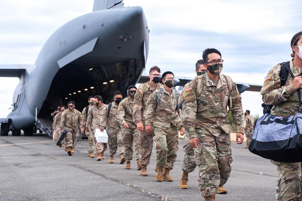 Hawaii National Guard soldiers and airmen depart a C-17 Globemaster III May 26, 2020, Kapolei, Hawaii.