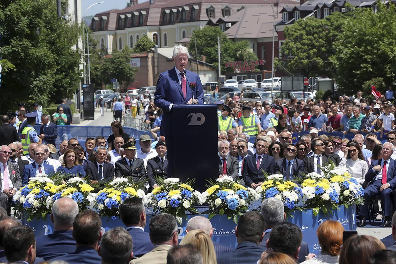 Former U.S. President Bill Clinton speaks during anniversary celebrations in the capital Pristina, Kosovo