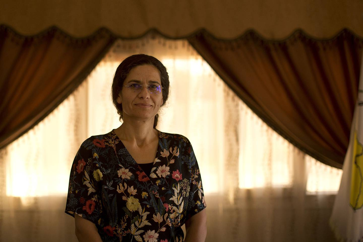 In this Sept. 3, 2019, photo, Ilham Ahmed, co-chair of the executive committee of the U.S-backed Syrian Democratic Council, speaks during an interview in Darbasiyah, Syria.