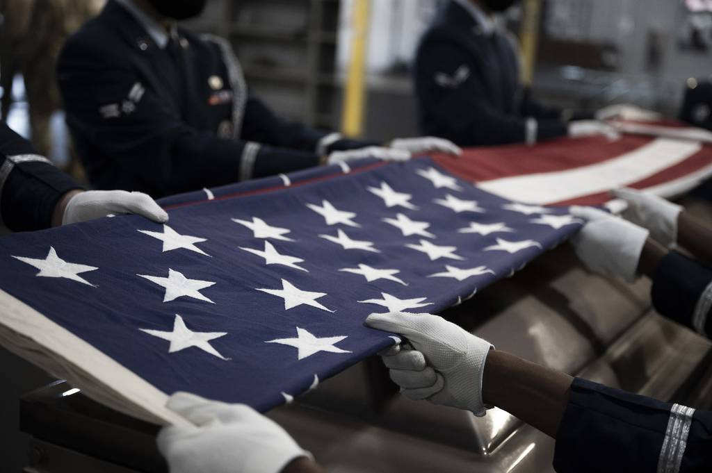 Ceremonial Guardsmen of the Base Honor Guard fold the American flag during a practice exercise at Little Rock Air Force Base, Ark., Aug. 25, 2020.