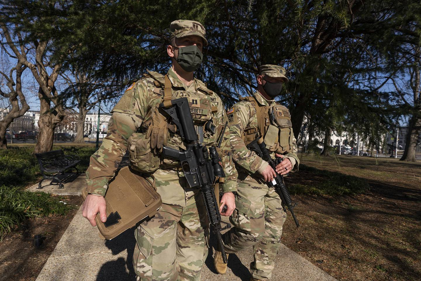 Armed members of the Maryland National Guard secures the perimeter around the U.S. Capitol, Wednesday, Jan. 13, 2021, in Washington.