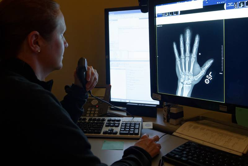 Lt. Cmdr. Victoria Campbell, assigned to Naval Hospital Camp Pendleton, reviews an x-ray in the radiology department on May 3, 2019.