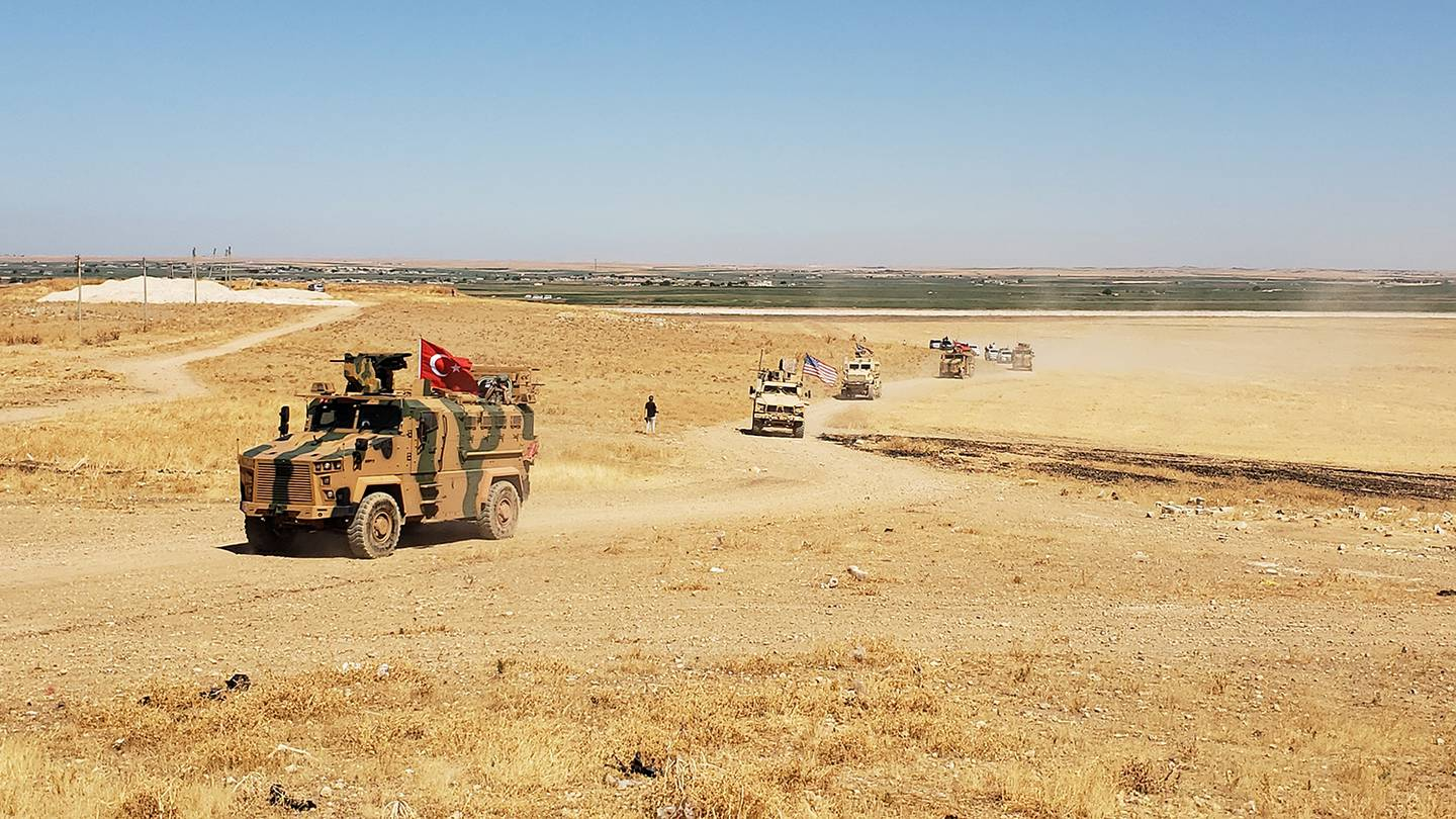 U.S. and Turkish military forces conduct a joint ground patrol Sept. 8, 2019, inside the safe zone established in northeast Syria.