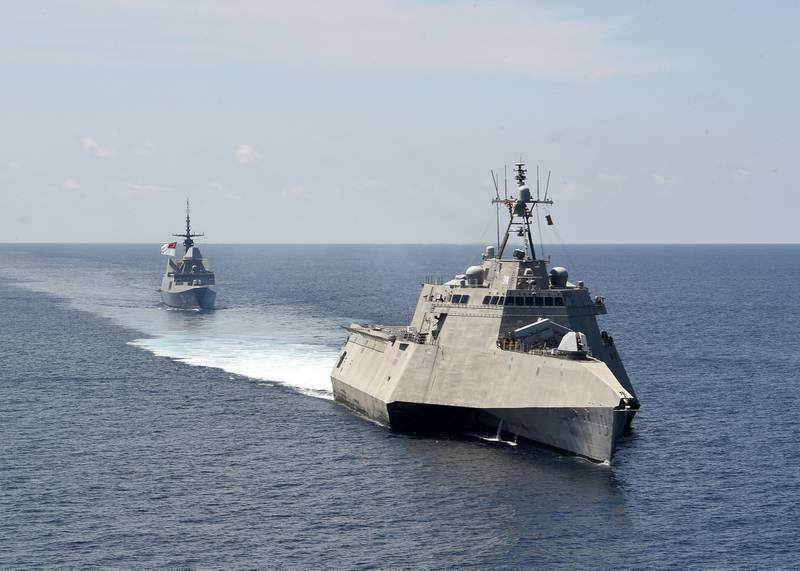The Independence-variant littoral combat ship USS Gabrielle Giffords (LCS 10), front, exercises with the Republic of Singapore navy Formidable-class multi-role stealth frigate RSS Steadfast (FFS 70) in the South China Sea, May 25, 2020.