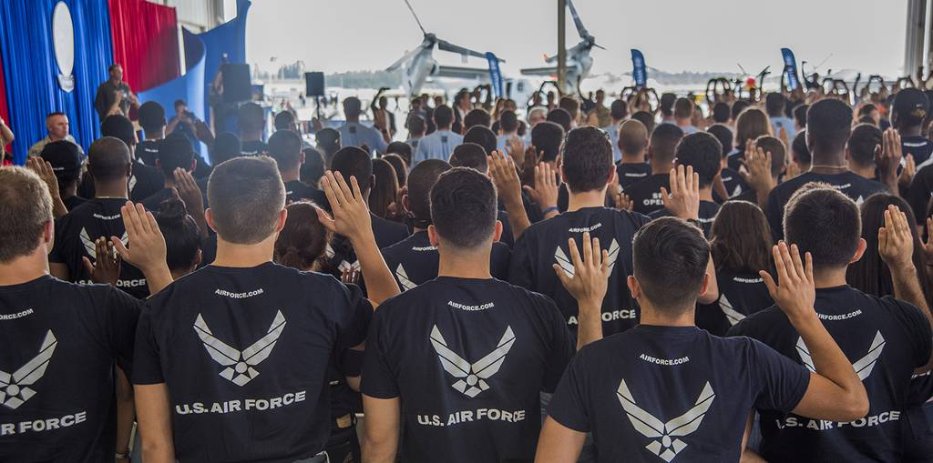 U.S. Air Force recruits take the oath of enlistment during the National Salute to America's Heroes on Coast Guard Air Station Miami, Opa-Locka, Fl., May 24, 2019.