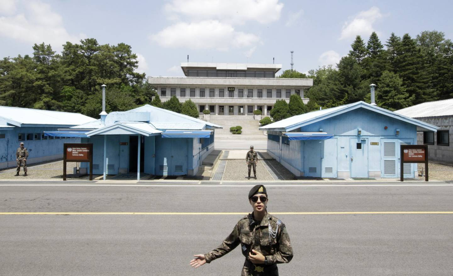 A South Korean soldier gestures during a press tour at the Panmunjom in the Demilitarized Zone, South Korea.