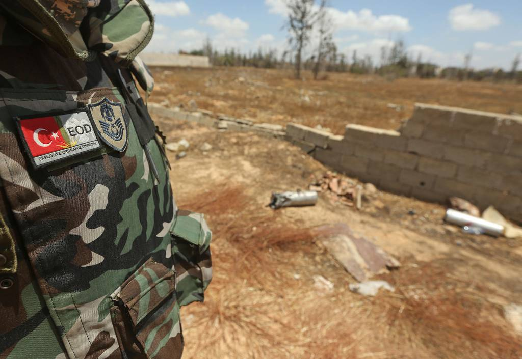 A Turkish deminer takes part in the clearance of unexploded ordnance remaining in the Salah al-Din area, south of the Libyan capital Tripoli, on June 15, 2020.