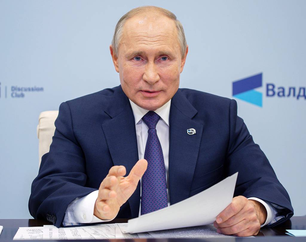 Russian President Vladimir Putin speaks as he participates in the annual meeting of the Valdai Discussion Club via video conference at the Novo-Ogaryovo residence outside Moscow on Oct. 22, 2020.