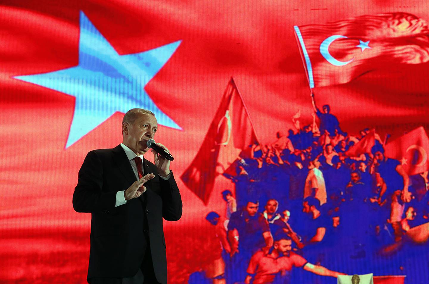 In this file photo dated July 15, 2019, Turkey's President Recep Tayyip Erdogan delivers a speech at a rally to honor the victims of the July 15, 2016, failed coup attempt, in Istanbul.