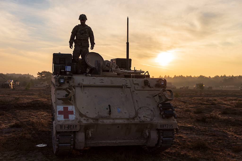 A soldier prepares an M113 armored personnel carrier for a convoy during a rapid-deployment exercise at Johanna Range, Poland,