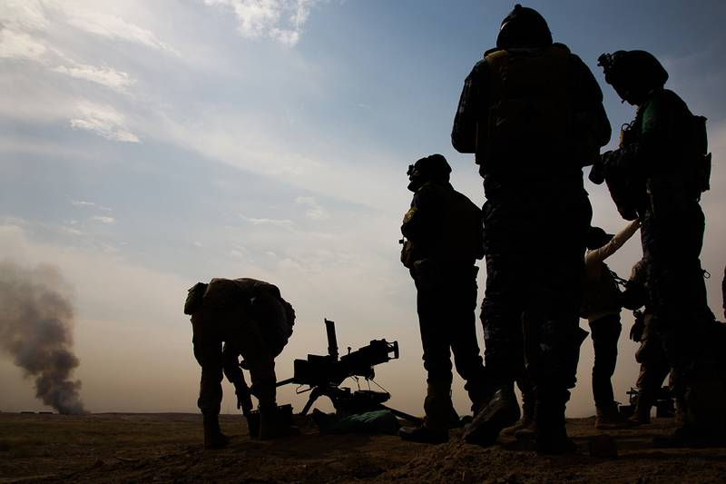 Iraqi federal policemen fire a M2A1 .50 caliber machine gun during a live-fire exercise at the Besmaya Range Complex, Iraq, June 10, 2019.