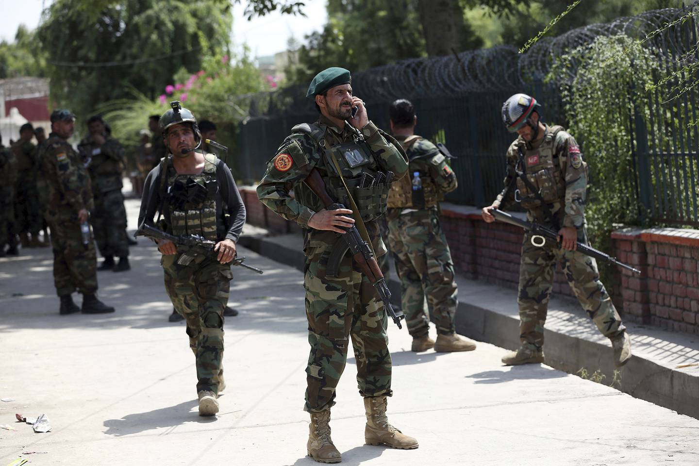 Afghan security personnel gather near a prison after an attack in the city of Jalalabad, east of Kabul, Afghanistan, Monday, Aug. 3, 2020.
