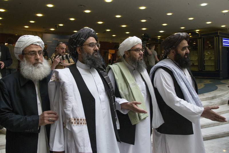 Mullah Abdul Ghani Baradar, the Taliban group's top political leader, second from left, arrives with other members of the Taliban delegation for talks in Moscow.