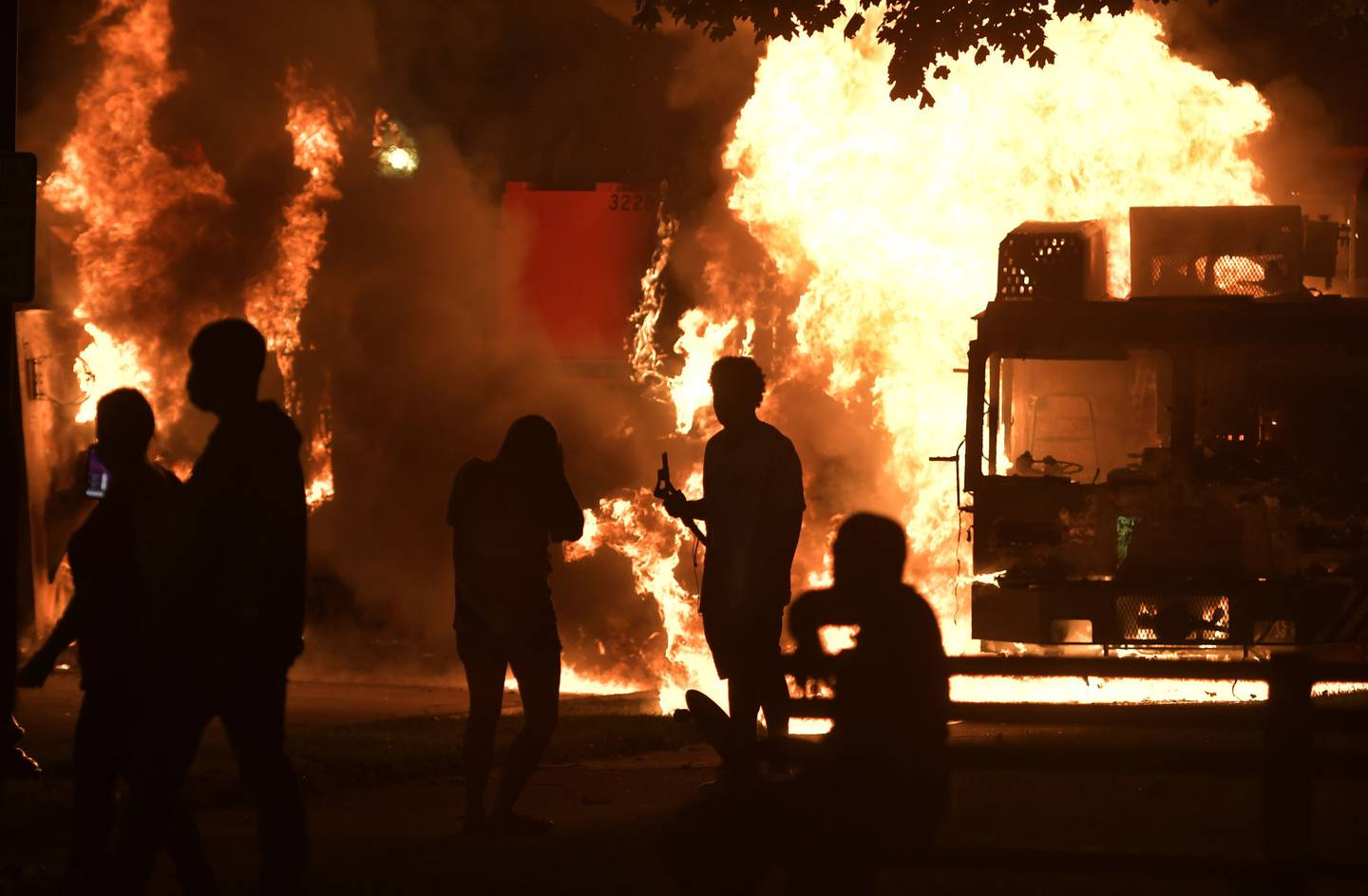 Garbage and dump trucks were set ablaze on Sunday, Aug. 23, 2020 by rioters near the Kenosha County Courthouse where they had been set up to prevent damage to the building.
